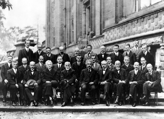 1927, Solvay Conference; bottom row, third from left: Marie Curie - woman physicist and chemist who conducted pioneering research on radioactivity. Also the first woman to receive a Nobel Prize (first person and only woman to ever to receive two).